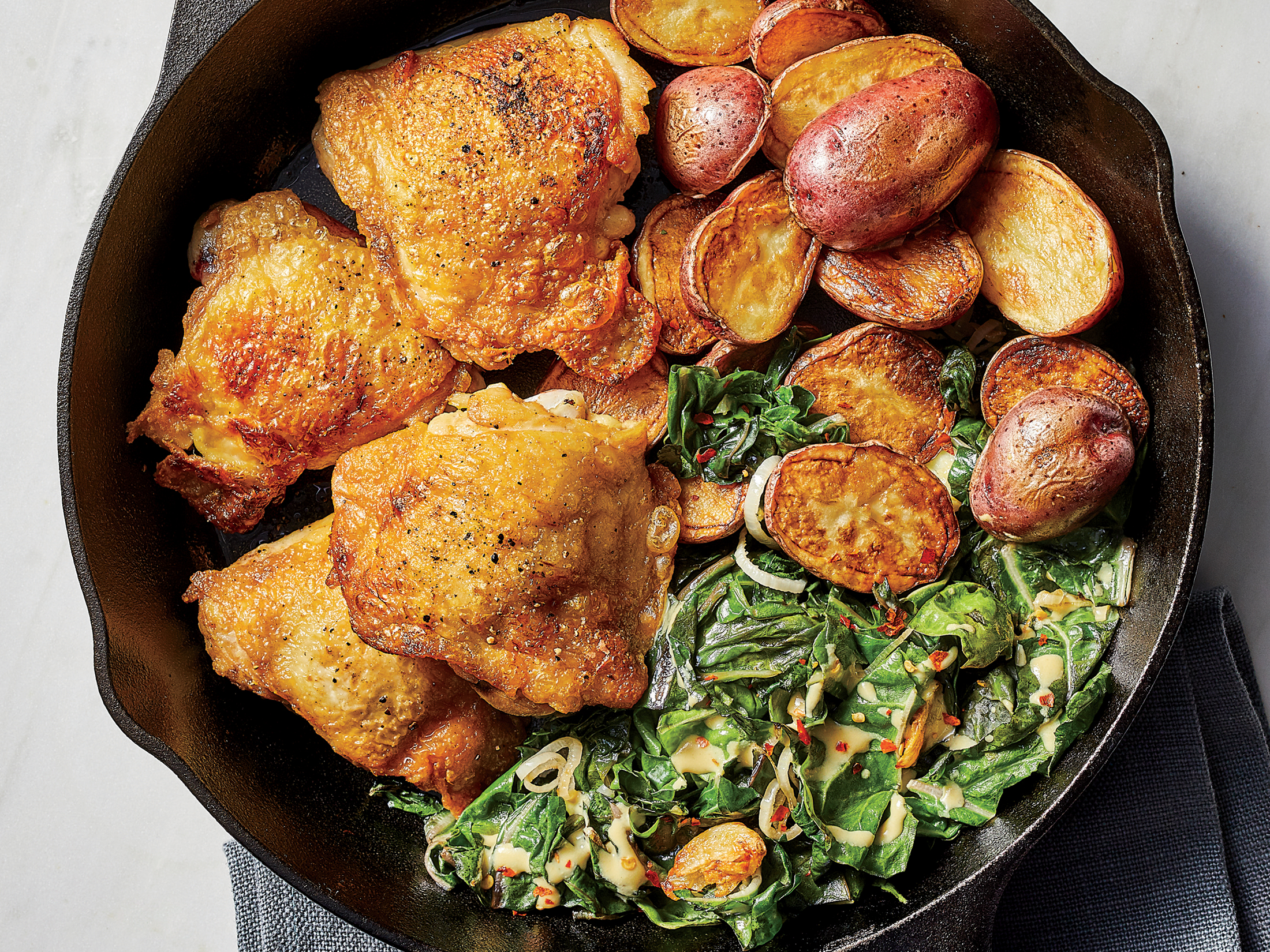 One-Pan Crispy Chicken Thighs With Potatoes and Chard