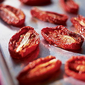 Summer tomatoes may need little help, but the oven-drying process greatly improves the quality of winter tomatoes.  The concentrated flavor that results from cooking tomatoes at a low temperature for a long time provides instant richness and depth to a me