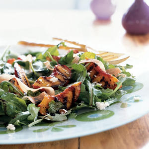 This salad combines sweet caramelized peaches, crispy meaty prosciutto, creamy tangy goat cheese, and slightly bitter arugula in a balsamic-honey dressing.