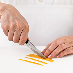Cut peel into 1/4-inch-thick strips 3 inches in length. (Yield: about 40 strips per fruit.)
