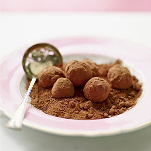 Chocolate truffles on a plate of cocoa powder
