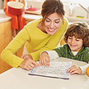Woman and boy planning menus