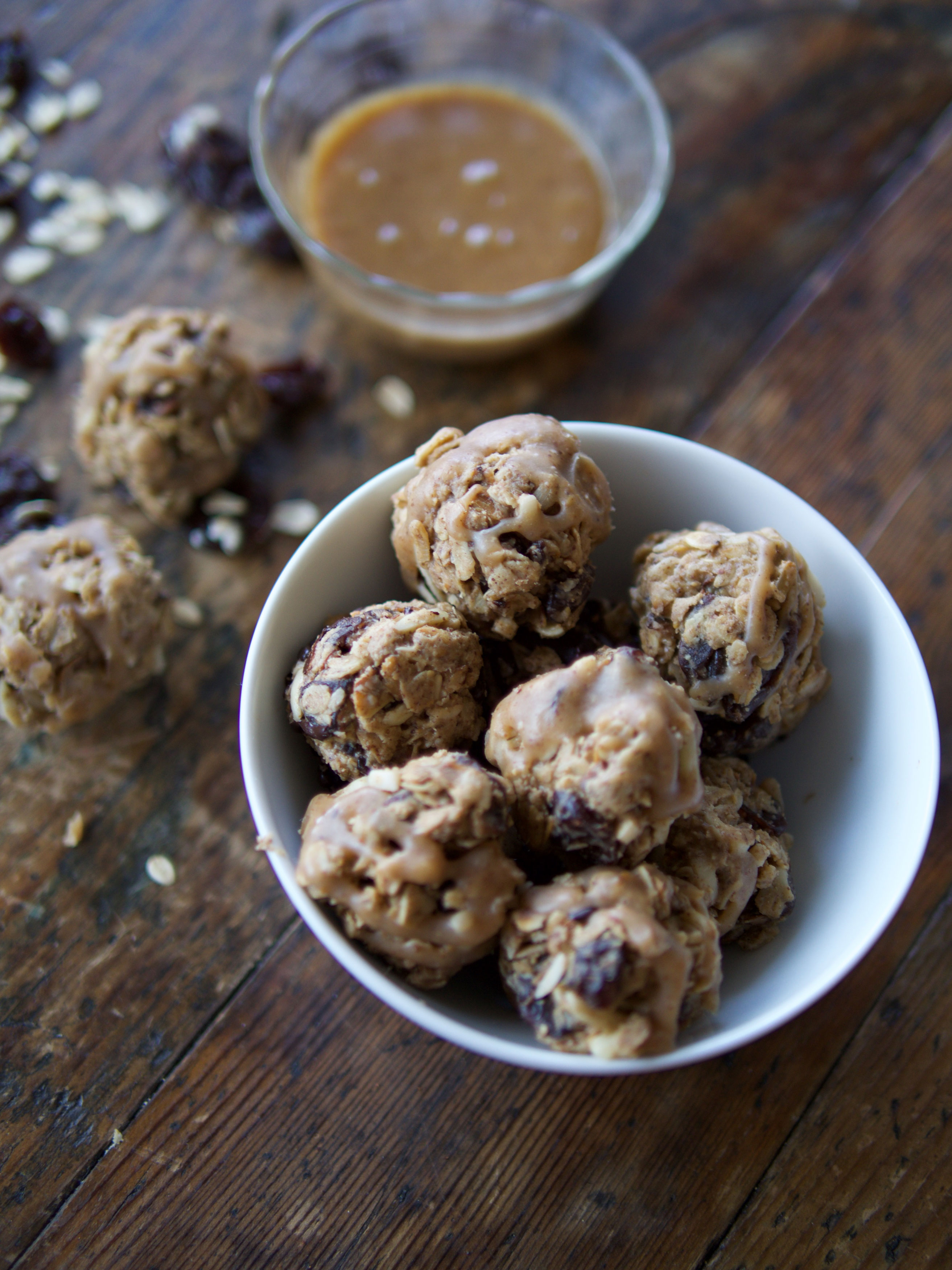 Almond Cherry Oat Balls with Vegan Caramel Drizzle image