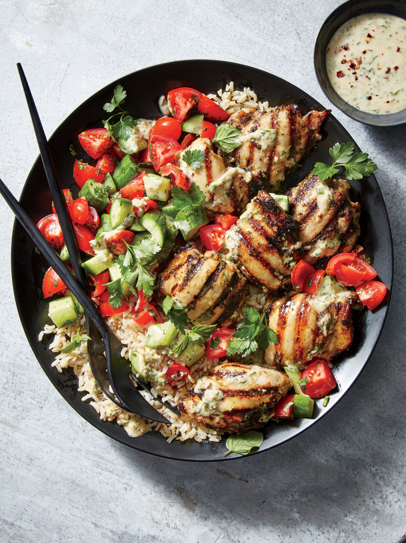 Tahini-Marinated Chicken Thighs with Cucumber-and-Tomato Salad