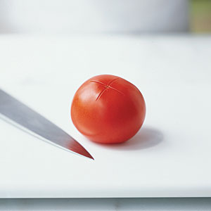 Cut a 1-inch x in the bottom of the tomato