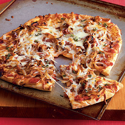 your pizza with the sauce, prosciutto, onions, and cheese. This pizza ...