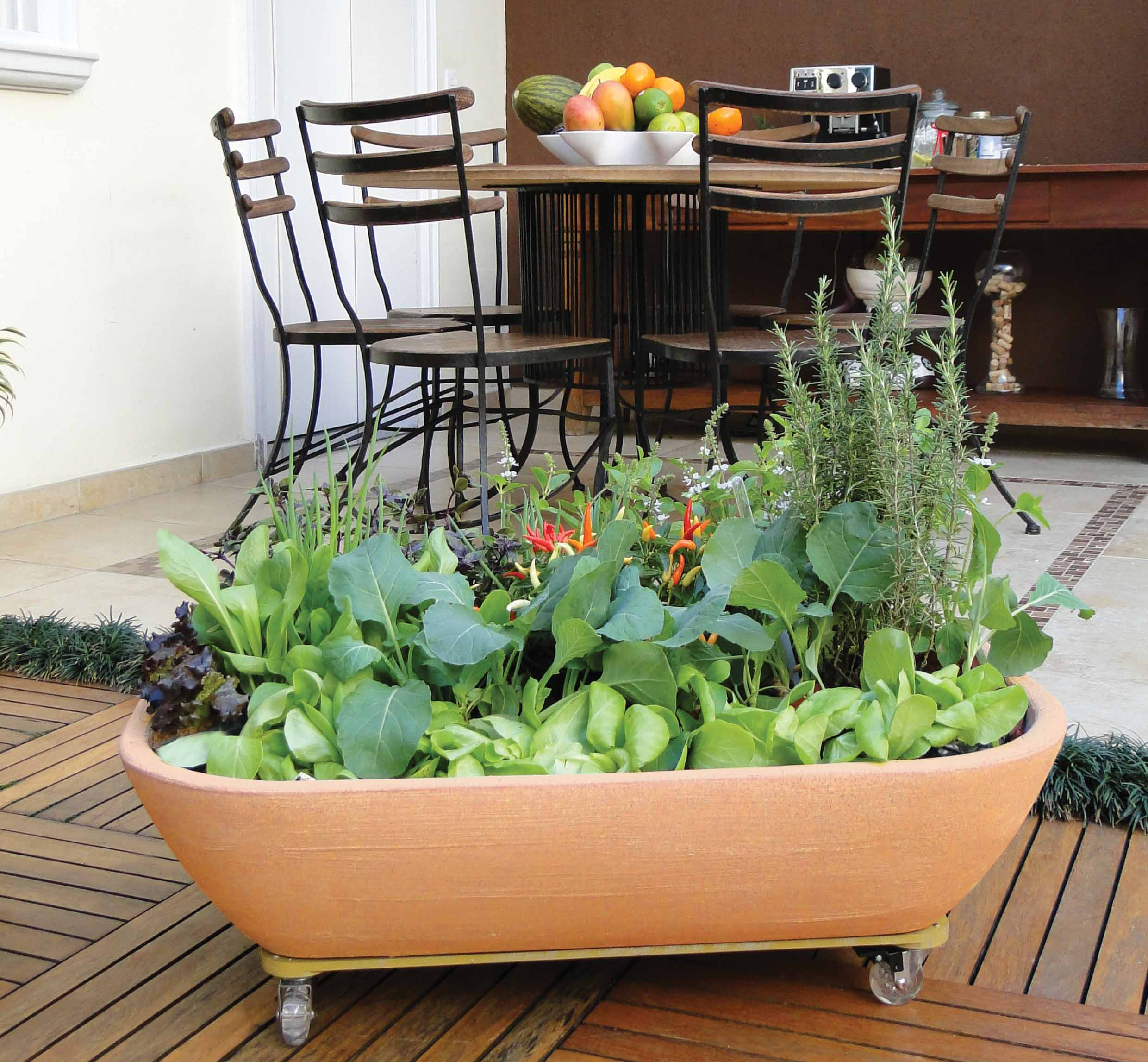 This self-watering kitchen planter is a smart choice for salad greens or frequently used herbs. Credit: Jackson Pottery / jacksonpottery.com