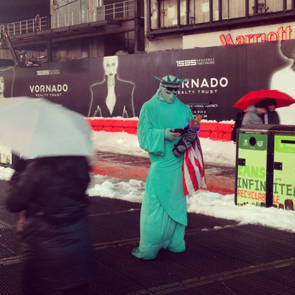 Lady Liberty counts her steps: New Yorkers trudged around, even during the storms.  Photo by Scott Mowbray