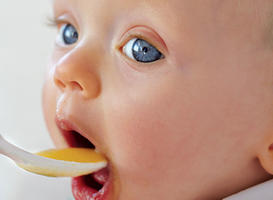 Cute baby eating baby food