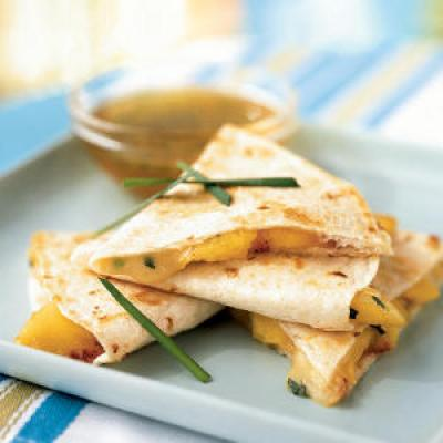 We've completely reinvented this Mexican classic to take advantage of summer. The mild brie rounds out caramelized peaches without overpowering, while the sweet-tangy sauce brings it all together.