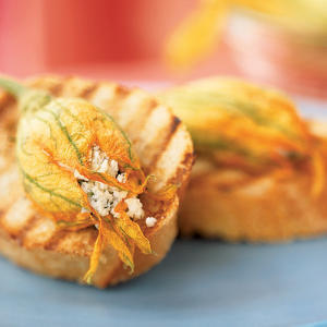 Most summer produce is available year-round at supermarkets today, but not so with squash blossoms. These special treats can only be found between late spring and early fall. Their subtle taste goes well with soft cheese and fresh herbs, and we pair them