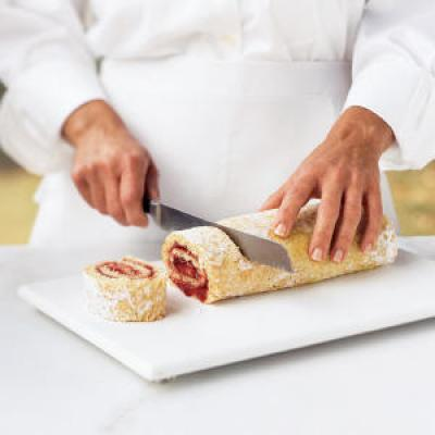 First, spray the pan with cooking spray, line with a sheet of wax paper, then coat the wax paper with cooking spray.