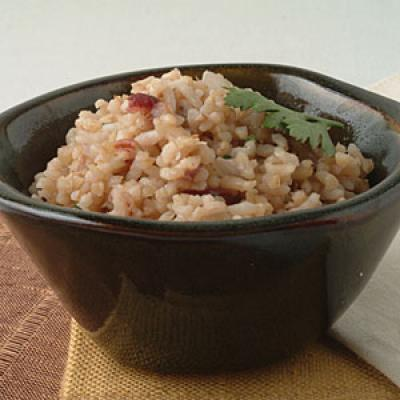Incorporating whole grains into a meal is easy when complemented by sweet-tart dried cranberries and rich toasted pecans.  Simmering the rice in chicken broth instead of water gives rice a flavor boost.