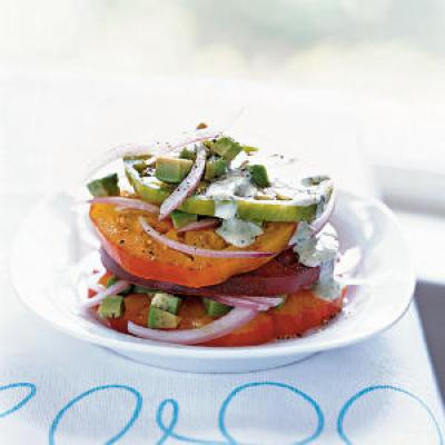 For many, fresh tomatoes are the purest expression of summer in food form. This dish takes advantage of their flavor as well as the dazzling palette of colors that heirloom varieties display. Topped with ripe avocado and a simple creamy dressing, this is