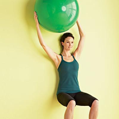 Holding wall squat with ball press