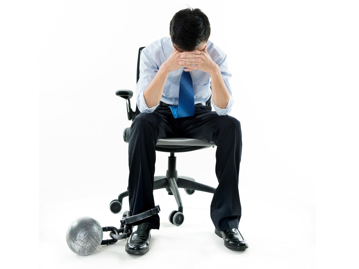 Businessman Chained to Desk