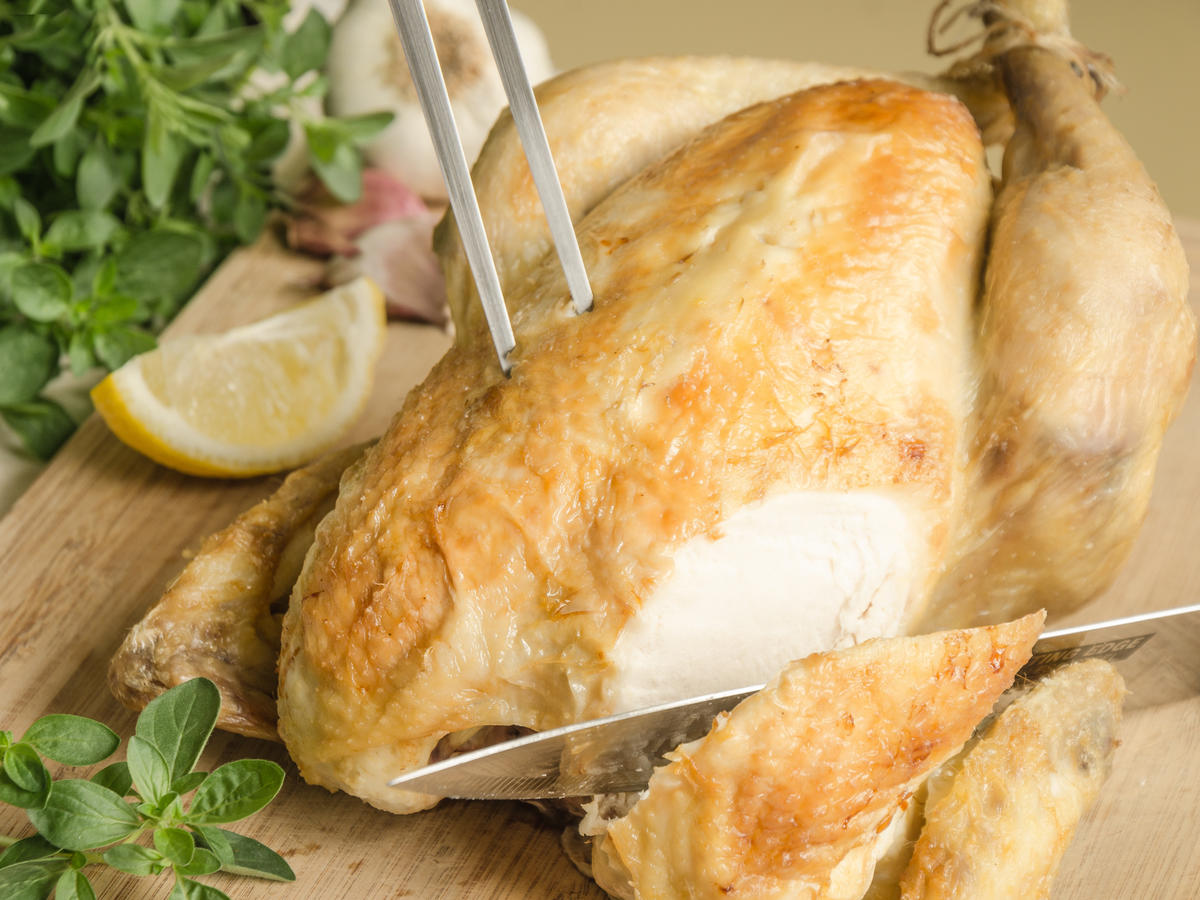 Whole Roasted Chicken on Carving Board