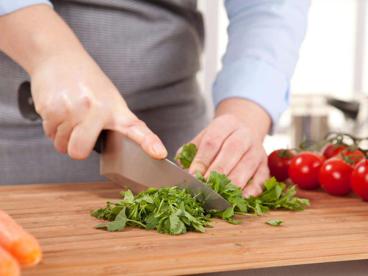 Woman Chopping Parsley