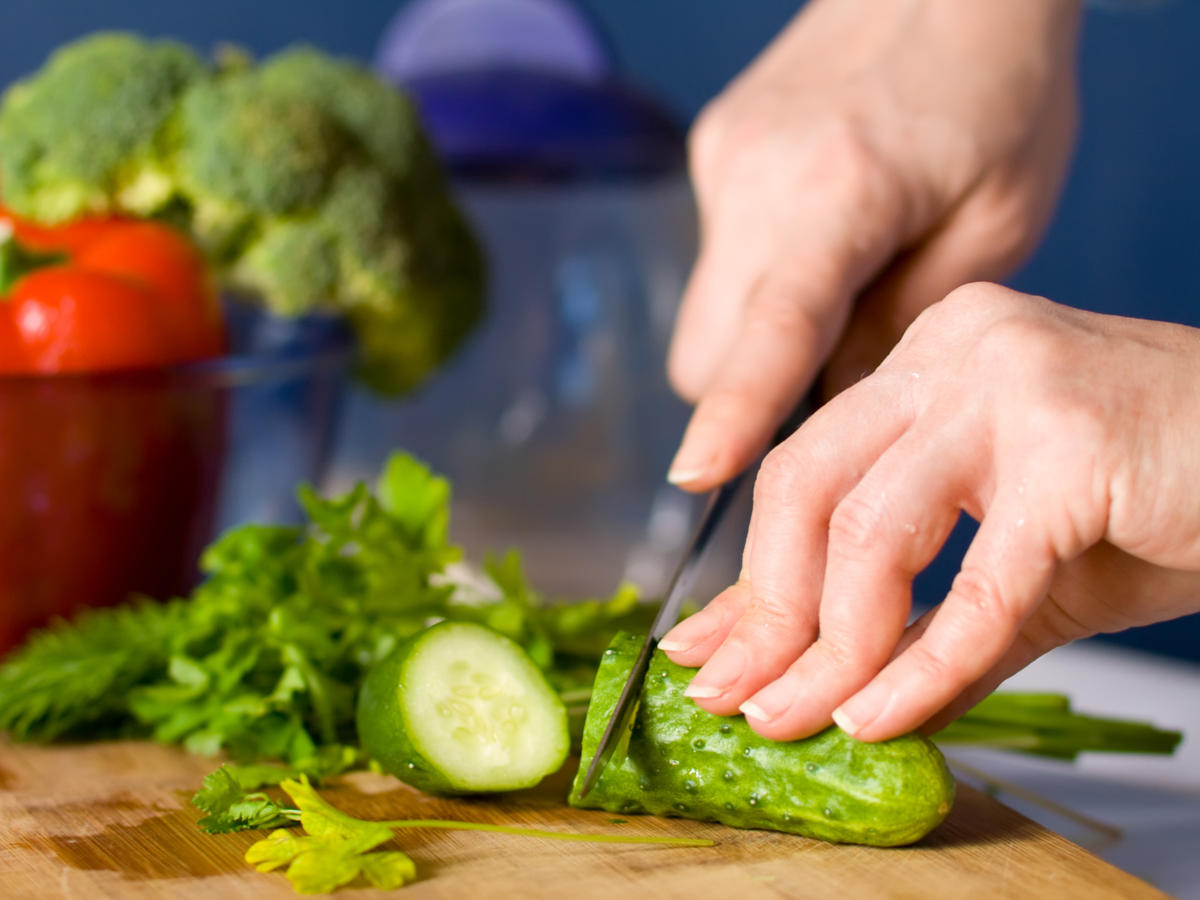Woman Slicing Cucumber