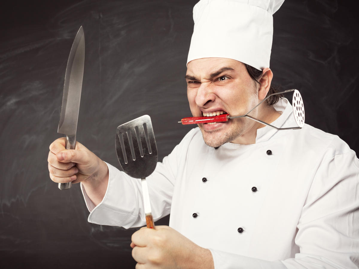 Crazy Chef Holding Knife