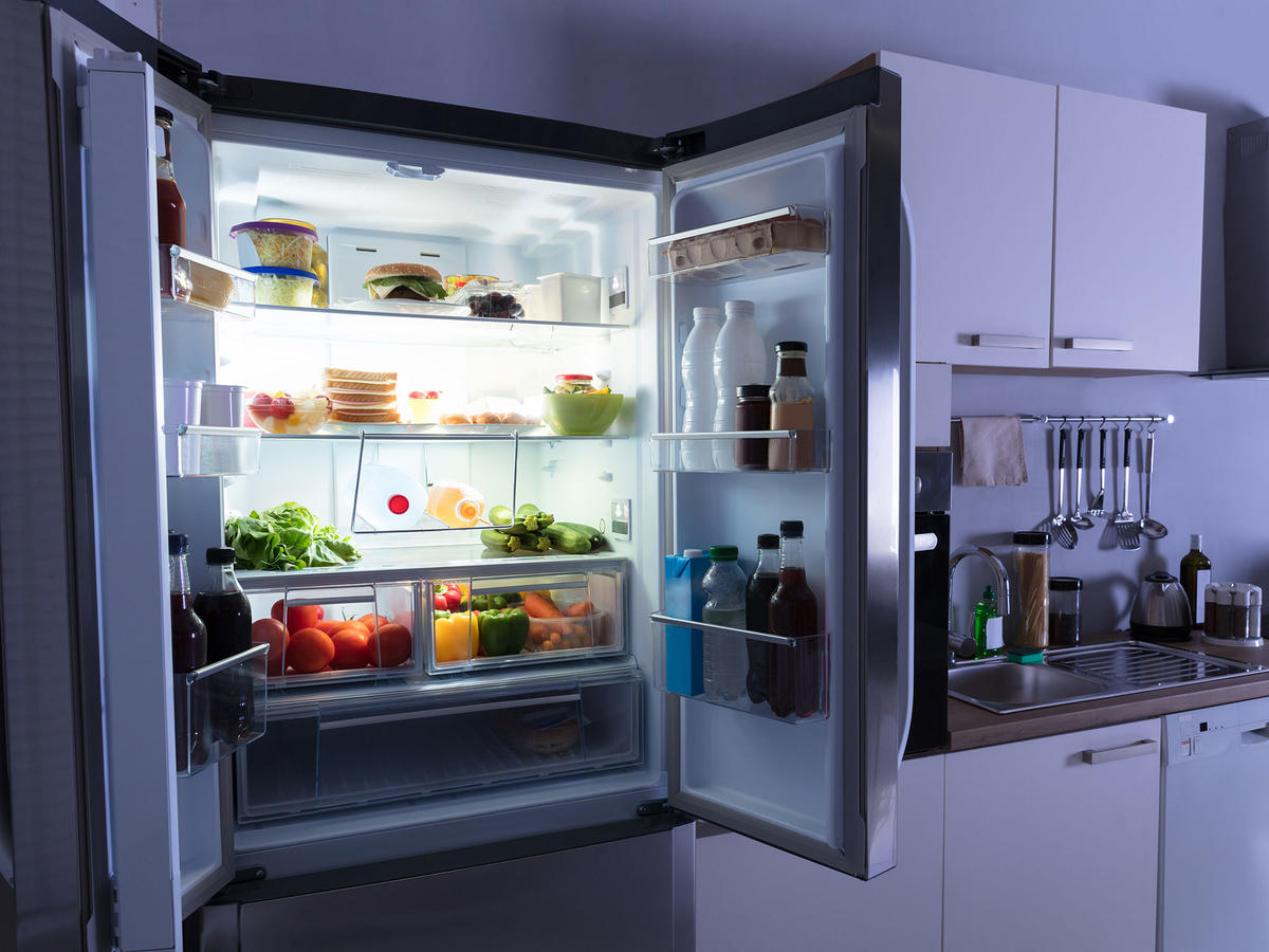 Refrigerator in a kitchen at night