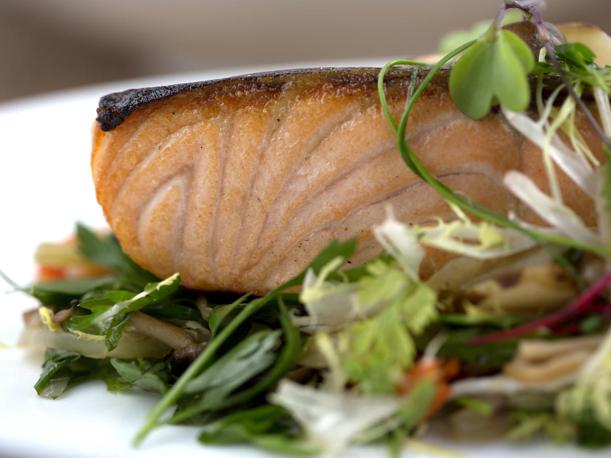 Scottish salmon on a bed of greens.