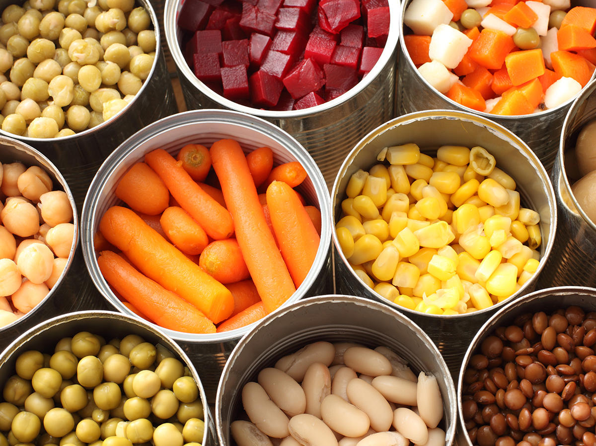 High angle view of cans filled with vegetables - stock photo