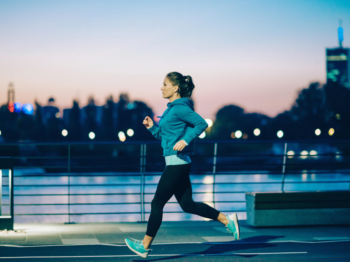 woman running exercise outside fall fitness