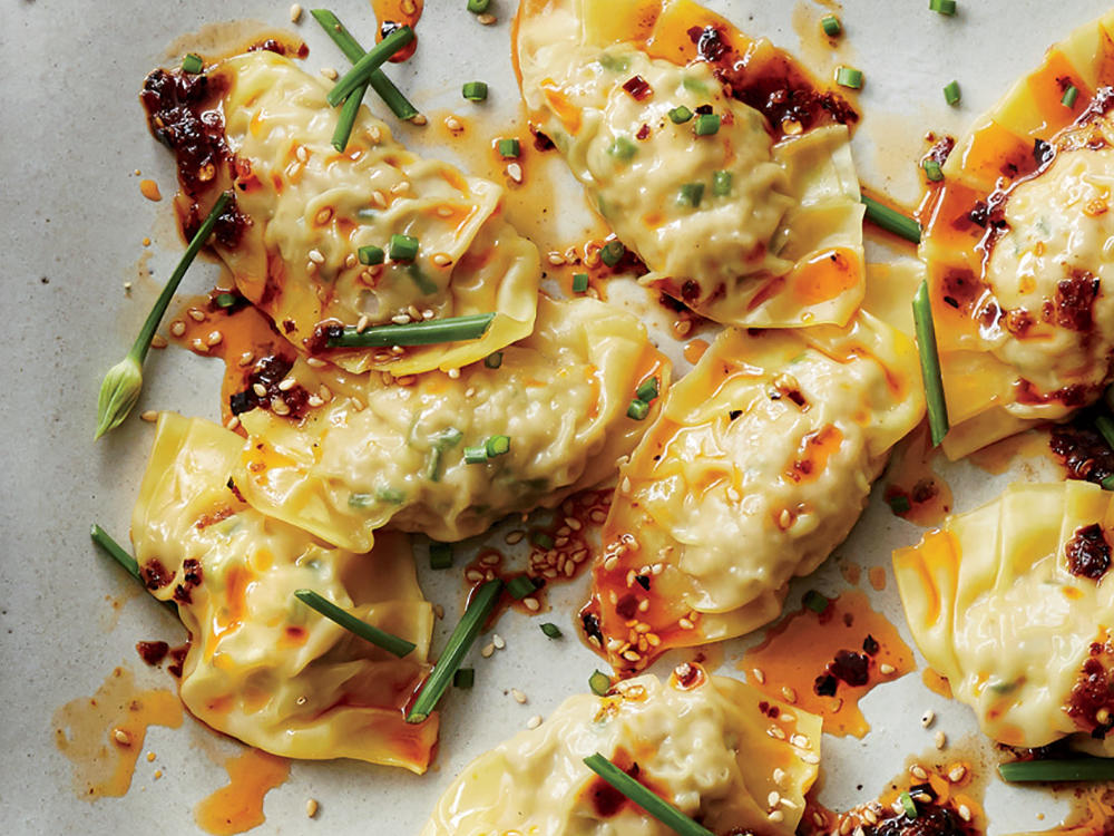 1604p99-pork-chive-dumplings-red-chile-oil-tight-crop.jpg