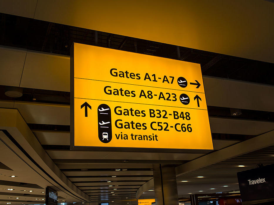 1605w-getty-airport-sign-plane-travel-flying-flight.jpg