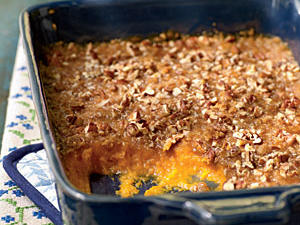 For this classic casserole, whip sweet potatoes until they're smooth and top with a delicious buttery brown sugar and pecan mixture.