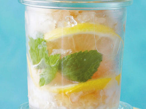 Along steep draws out the deeper flavors of the tea; take care not to squeeze the tea bags to avoid making the granita bitter. Garnish the granita with lemon or mint sprigs, if desired.