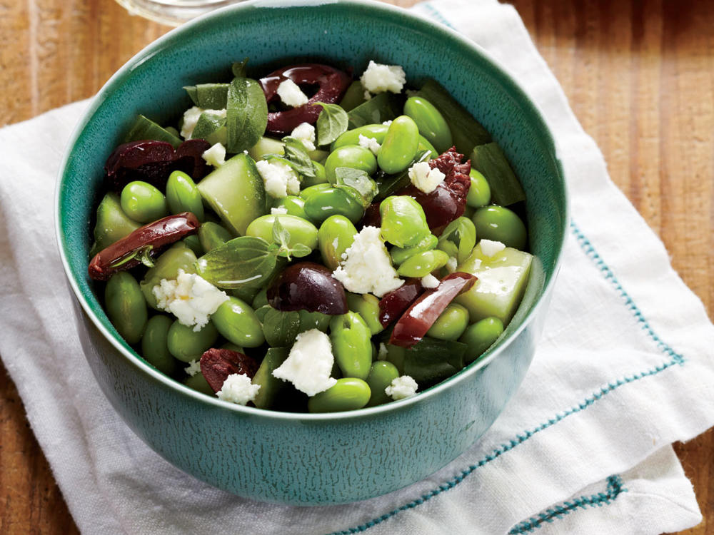 Edamame, a protein-packed legume, is tossed with crumbled feta and sliced kalamata olives in this flavor-packed side.