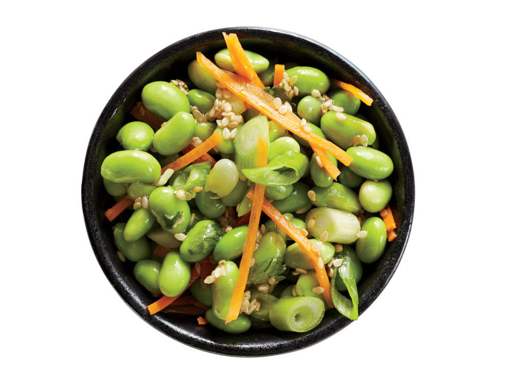 Fresh cilantro, rice vinegar, sesame oil, and shredded carrots give this edamame salad Asian flair.