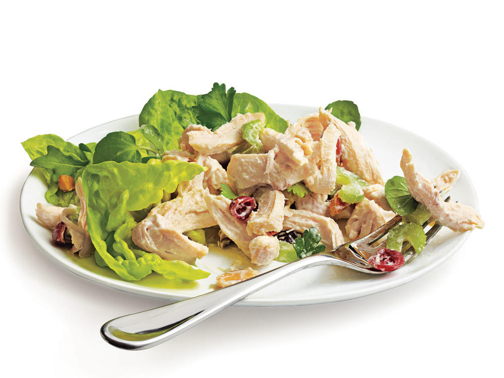 If you have longed for the perfect low-fat chicken salad recipe, look no further. Poaching the chicken keeps it moist and succulent, so you'll need less dressing to bind the salad.