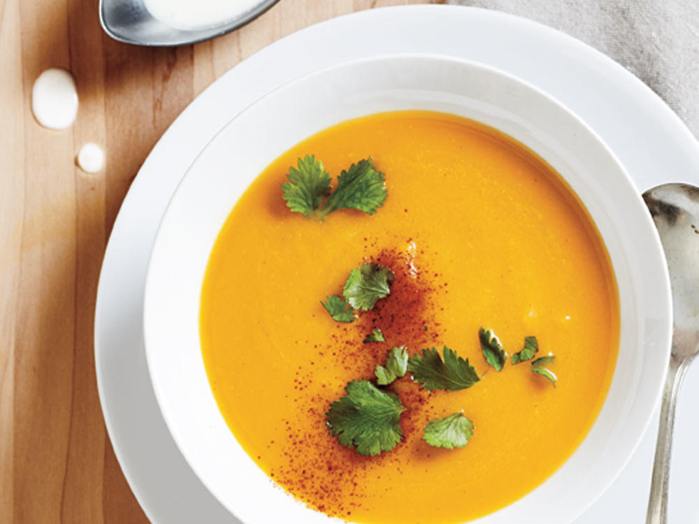 Serve this full-flavored soup as a first course, or as a smooth vegetable stew over rice with a side of cooked greens. We've used luxurious full-fat coconut milk, which yields a decadent, silky soup. You can use light coconut milk, if you prefer, for a soup with less body (and only 1g saturated fat per serving).
