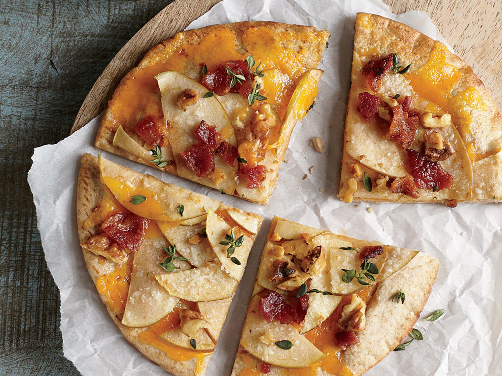 Smoky bacon, rich walnuts, and woodsy thyme give depth to these quick personal pizzas.
