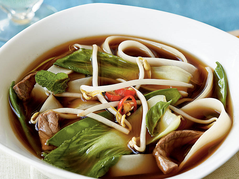vietnamese beef noodle soup with asian greens