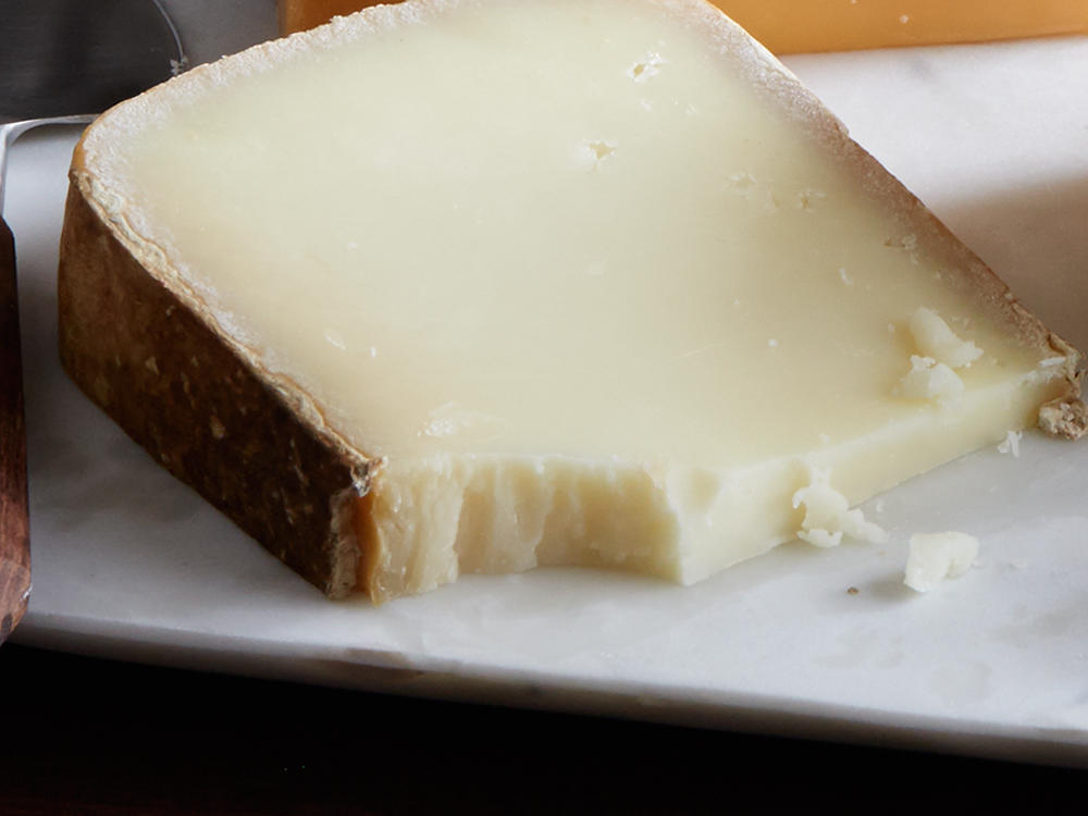 The aged sheep's milk wheels of the French Pyrenees mountains are among cheese lovers' top picks. Look for names like Istara, Ossau Iraty, or P'tit Basque for a dense, chewy texture and edging-on-caramel flavor. The flavor is intense, complex, and satisfying even in small bites. Serve at room temperature.