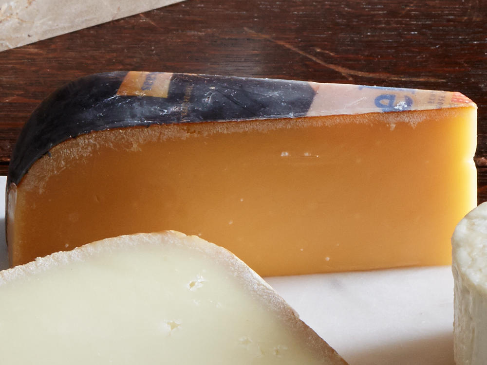 "This Dutch cow's milk cheese is aged a minimum of 18 months to a hard waxiness that breaks into chunks under knifepoint. With flavors of butterscotch, bourbon, and salt, it's often called the ""candy of cheese."" Look for big white patches, which are amino acid clusters that add a crystalline crunch. Other brands to seek out: Reypenaer, Beemster XO, Parrano, and U.S.-made Marieke Gouda. Serve at room temperature.
