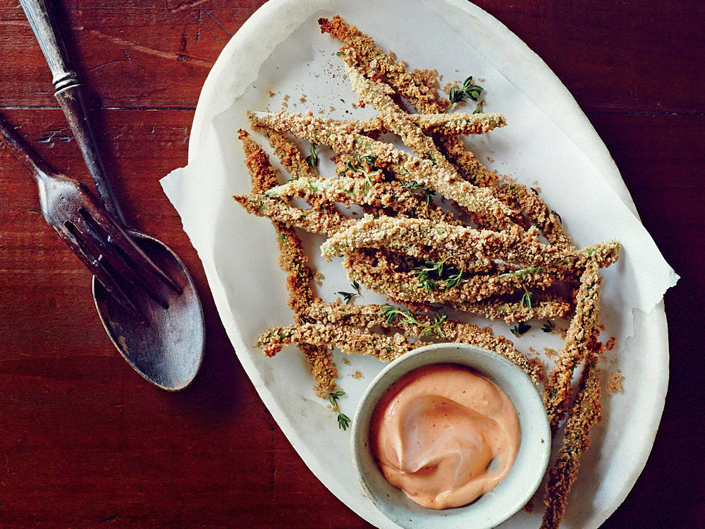 Day-old veggies become irresistible crunchy munching sticks thanks to a coarse breadcrumb coating. Tangy chile dip takes flavors to the spicy edge.