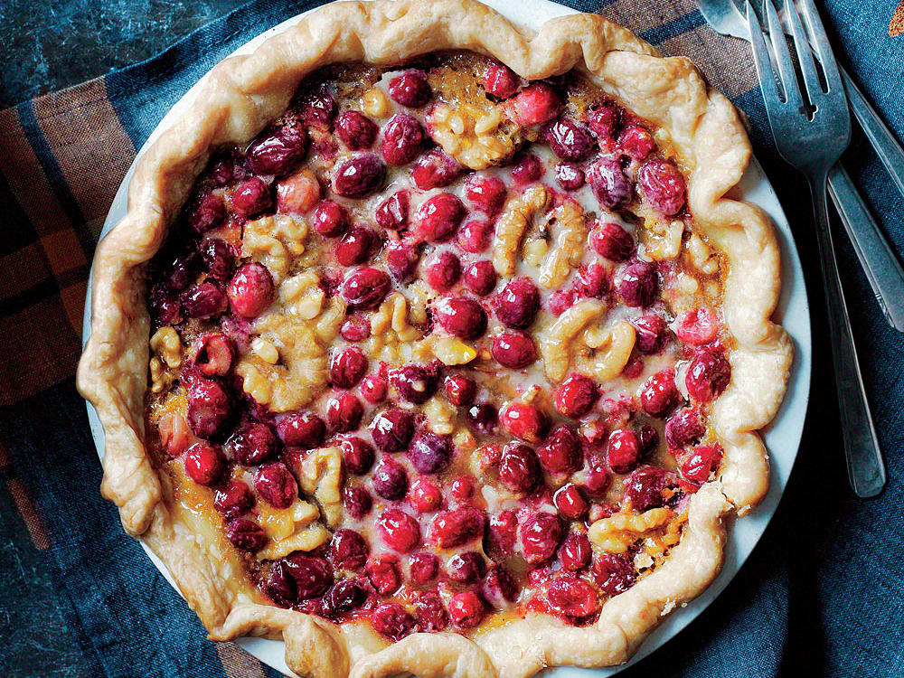 While the buttery, maple-scented filling is inspired by classic pecan pie, we swap in toasted walnuts and add chopped fresh cranberries for a beautiful pop of color and tart flavor contrast that cuts the sweetness.