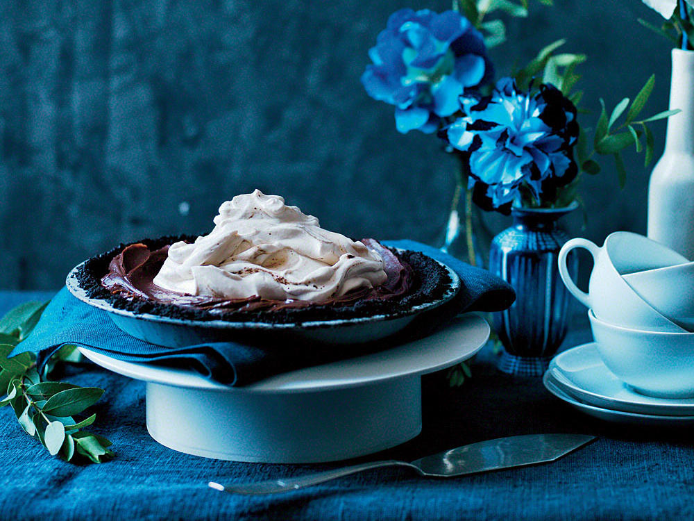 This pie comes together quickly and won't hog oven space as it chills and sets in the fridge (a great make-ahead option). You can use decaf instant coffee granules instead of regular, or leave them out entirely for a silky-smooth chocolate pie with vanilla topping.