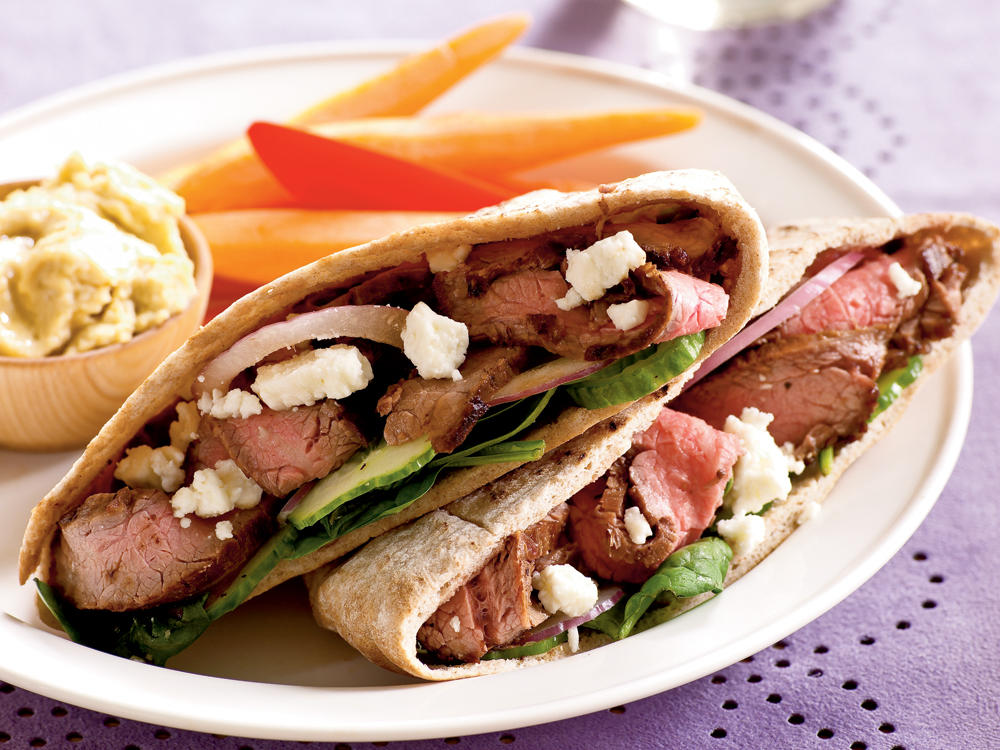 Serve a Mediterranean-inspired meal in minutes. These steak-filled pita sandwiches are stuffed with bright flavors including Greek seasoning, lemon juice, red onion, and feta cheese. Creamy hummus rounds out this meal.