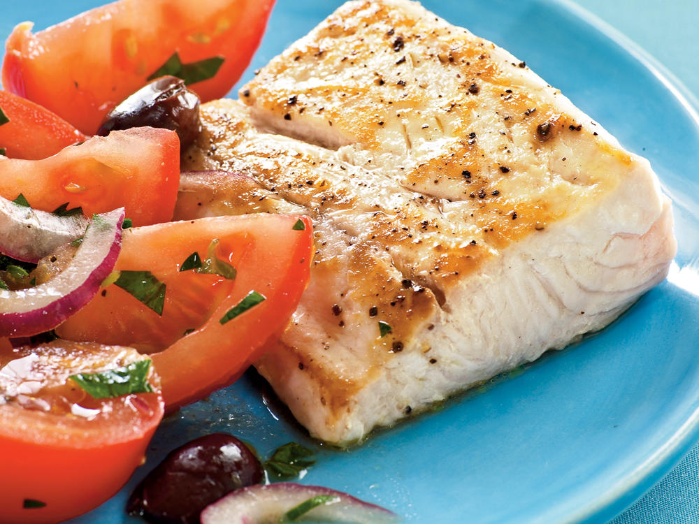 Serve a delicious Greek-inspired fish dinner that takes just 15 minutes to prepare and has under 250 calories per serving.