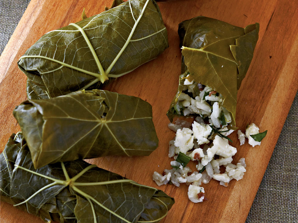 "A platter of Greek mezze (little dishes) typically includes grape leaves stuffed with seasoned rice. ""This classic Mediterranean dish makes a great party hors d'oeuvre,"" says Joanne Weir, James Bear Award-winning cookbook author and television personality."