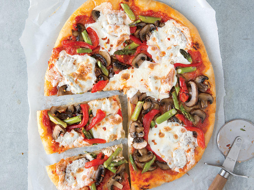 It's easy to skip delivery when pizza is so much fun to make at home. Load up the pie with as many veggies as you want.