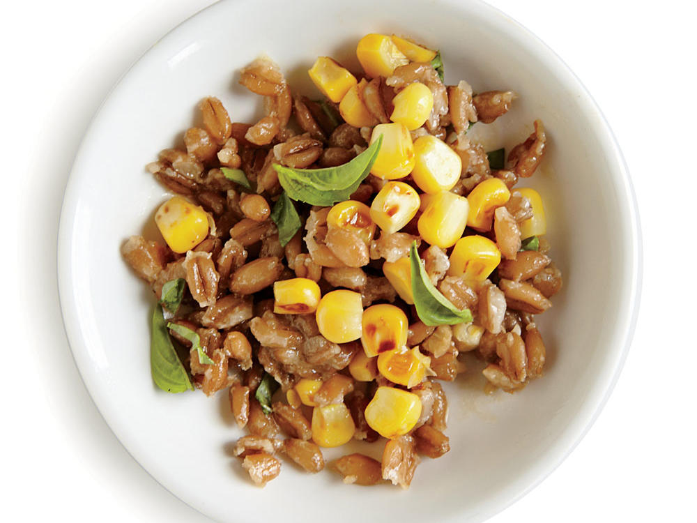 Tossing the farro in a light oil-based dressing melds the flavors in this simple side.