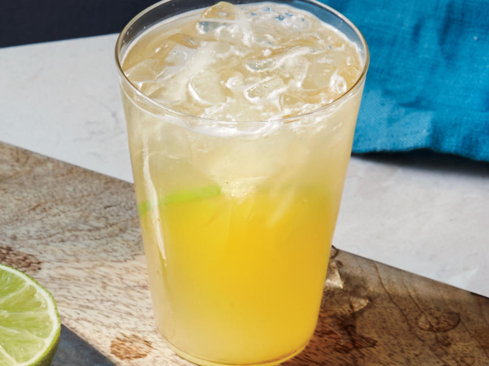 Perfect for your next taco night, this cocktail combines Mexican pale lager beer (such as Corona) with limeade for a tangy refreshing drink. Garnish with a lime slice.