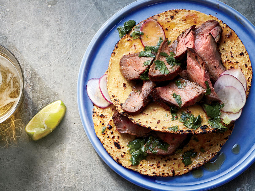 Turn your kitchen island into a Mexican street food cart offering Carne Asada-style tacos. Fresh cilantro leaves, orange juice, and glorious bold-flavored spices unite to leave a lasting impression on your guests.